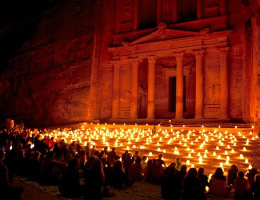 The temples of Petra in Jordan lit up by candles at night