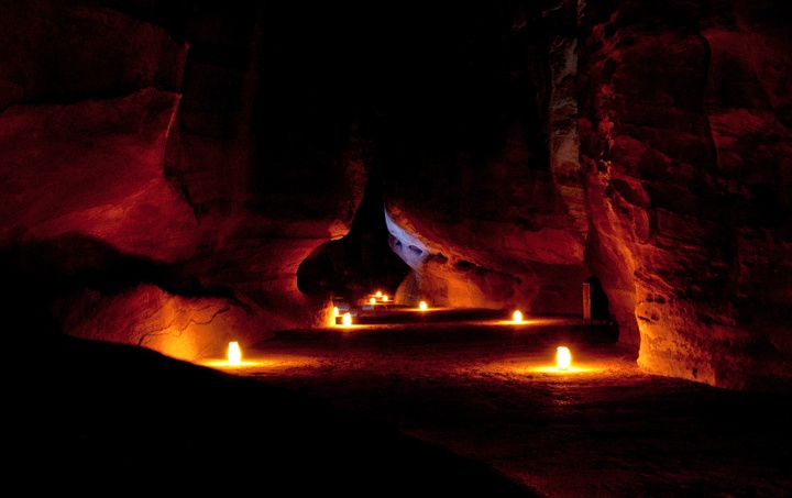 Candlelit pathway through Petra at night