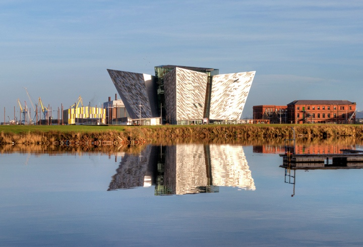 Titanic Belfast reflected in the water of the harbour