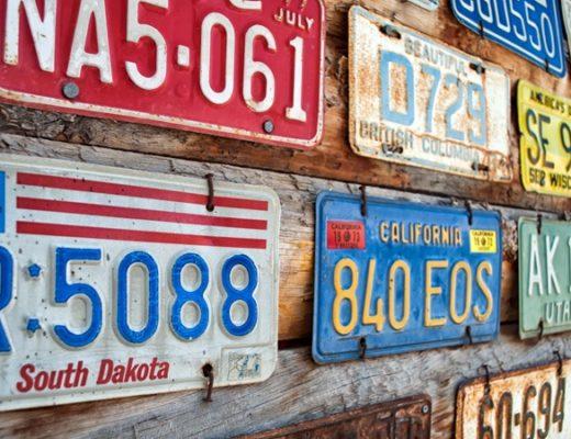 Vintage US numberplates on a road trip stop