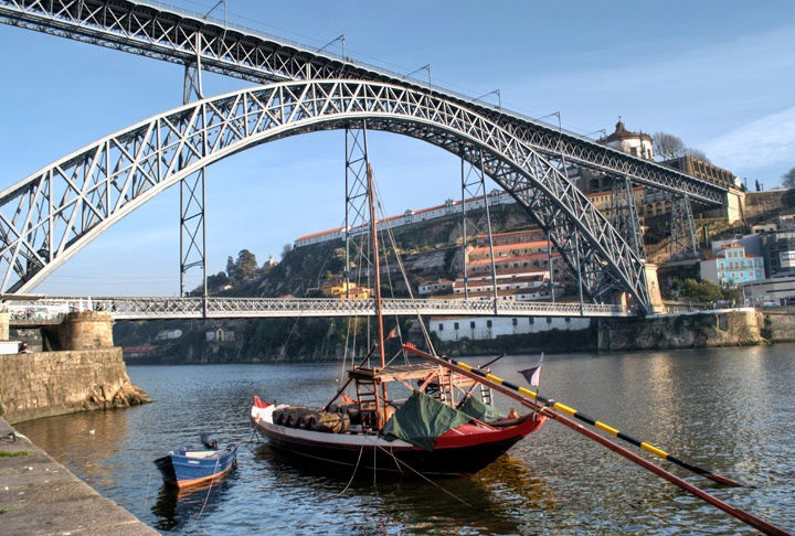 Port barge under the Dom Luis Bridge in Porto