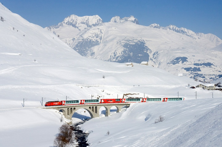 The Glacier Express scenic mountain train in the snow