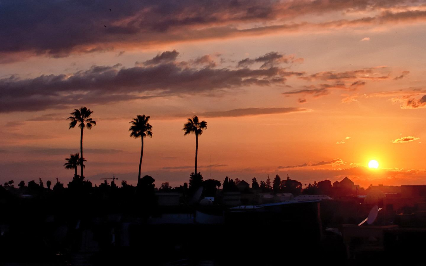 Sunset over the medina in Marrakech from Riad Capaldi roof terrace