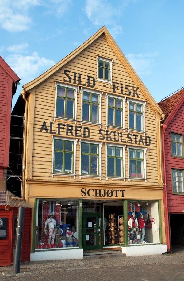 Among the colourfully painted shopfronts of Bryggen, the historic waterfront district of the Norwegian city of Bergen – ontheluce.com