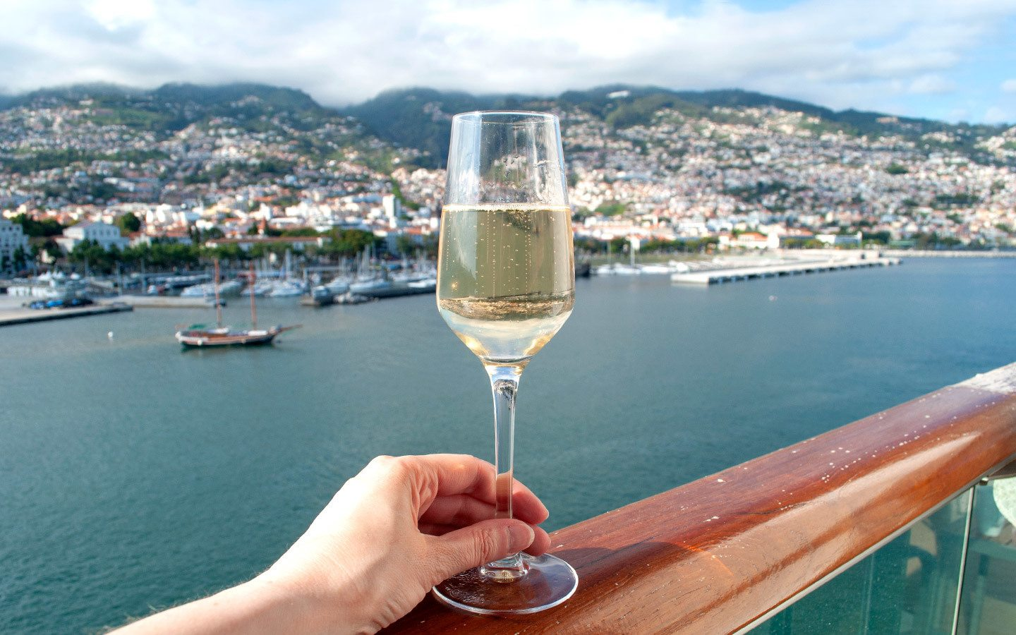 Glass of Champagne on cruise ship balcony overlooking Madeira