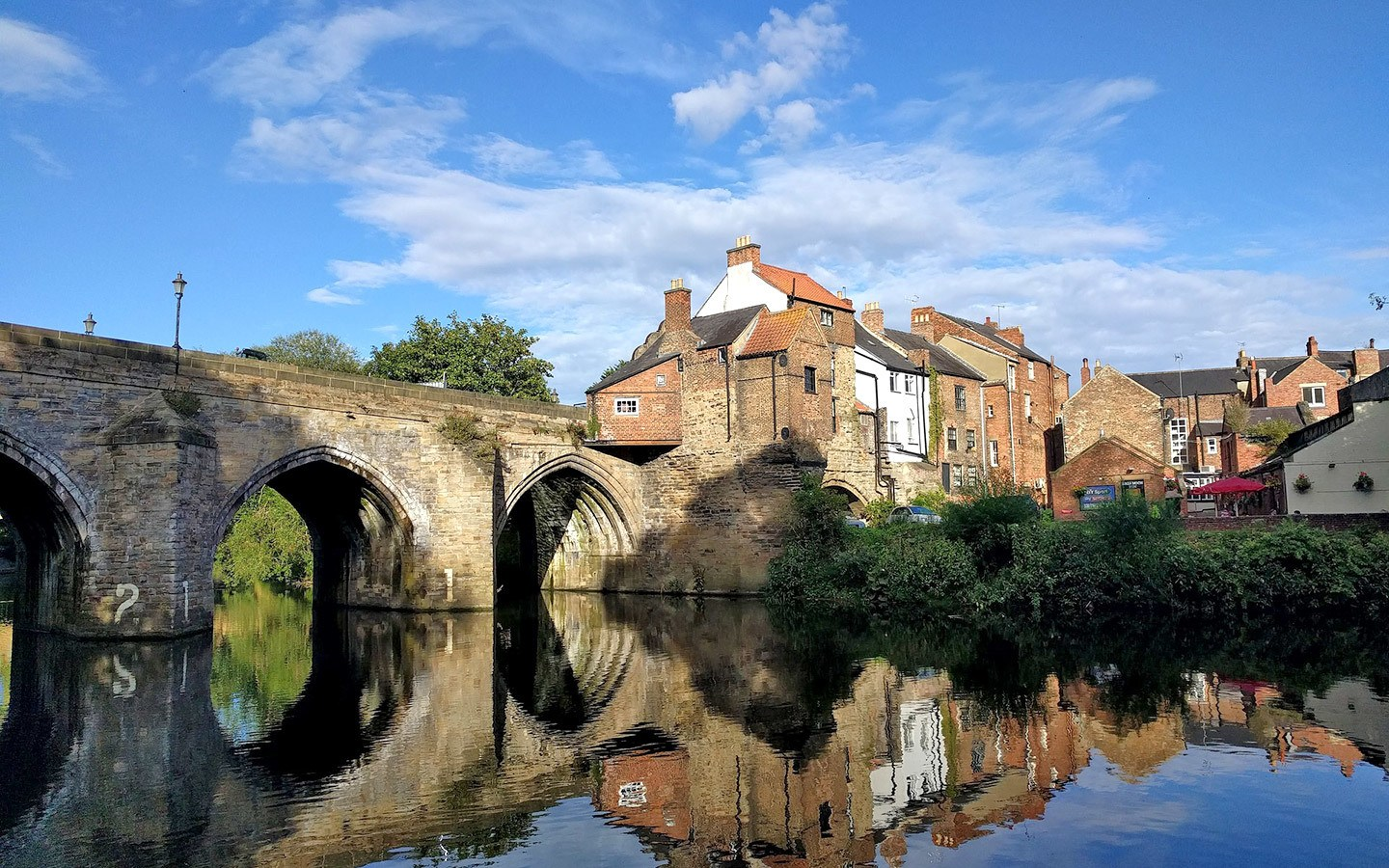Bridge and buildings on the riverside in Durham, an alternative to visiting Oxford
