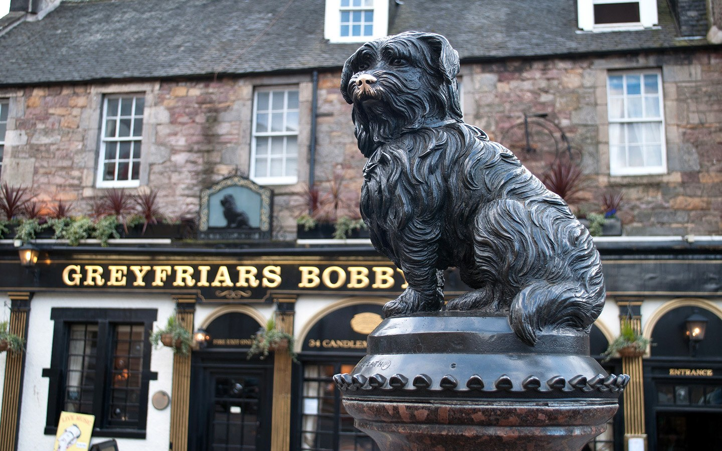 Greyfriars Bobby's statue and his namesake pub in Edinburgh