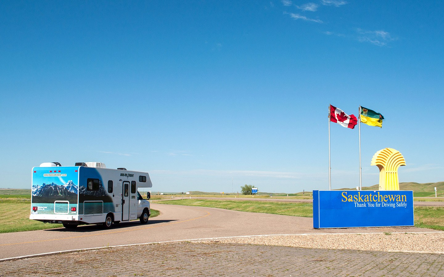 RV on Highway 1 in Canada crossing over into Saskatchewan on a Calgary to Toronto road trip