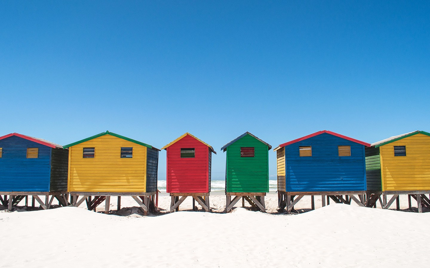 Colourful beach huts at Muizenberg beach, South Africa
