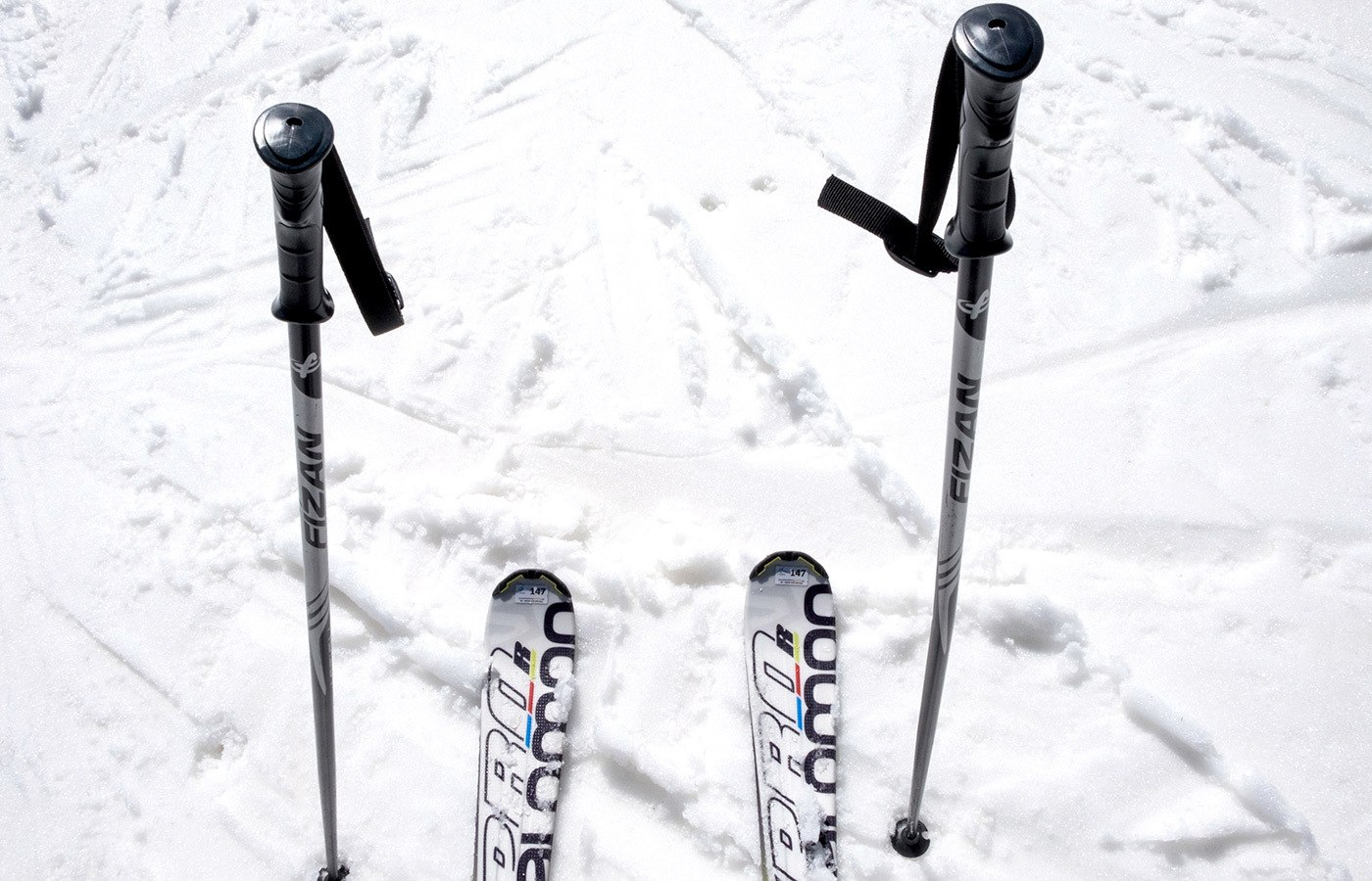 Skis and poles in the snow