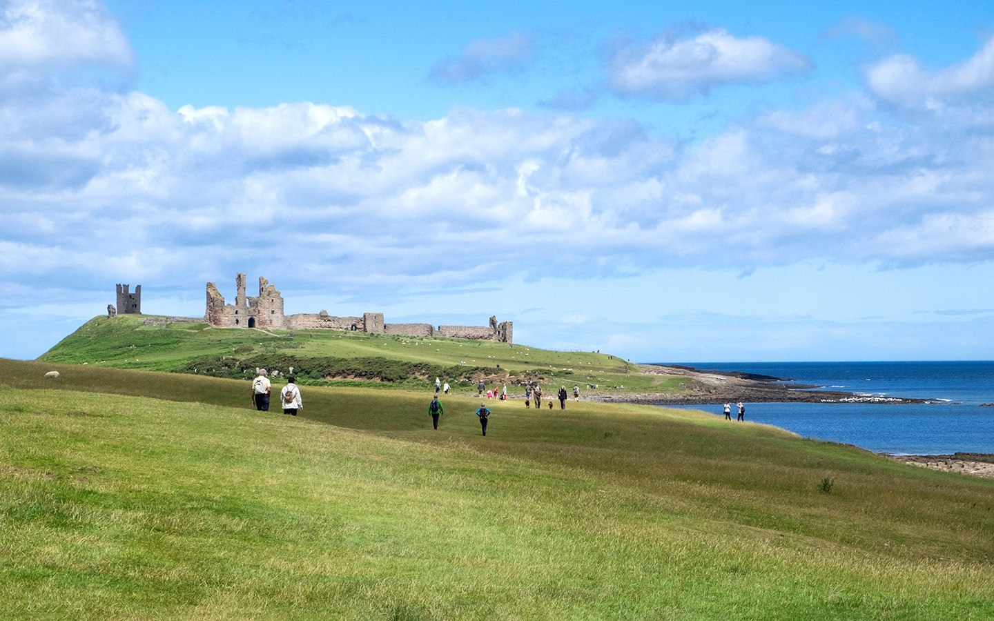 Dunstanburgh Castle on a UK walking holiday along the Northumberland Coast Path