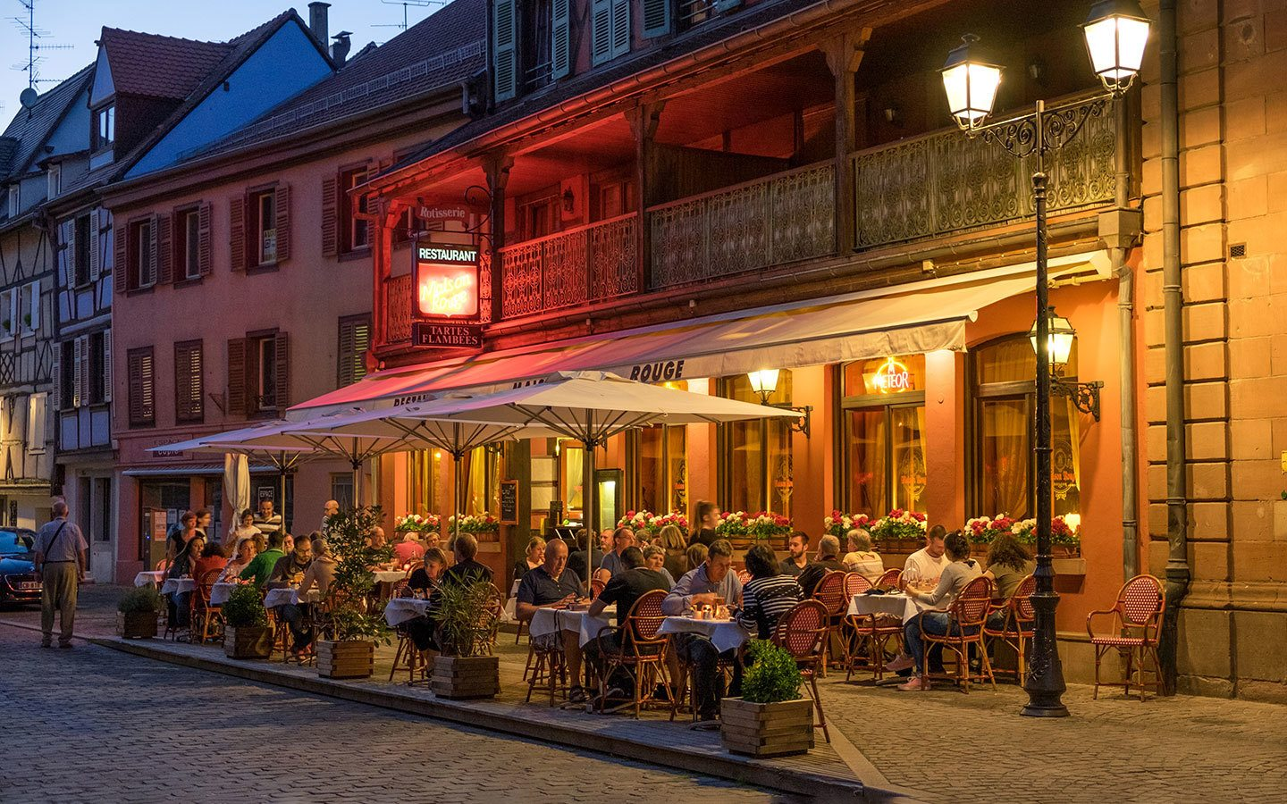 Diners outside a restaurant in Colmar, Alsace