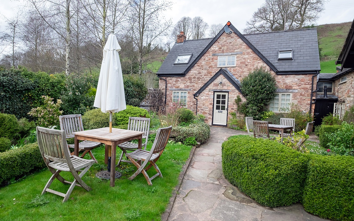 Exploring England's Forest of Dean with a luxury stay at the Tudor Farmhouse hotel in Clearwell, a former farm turned boutique hotel with award-winning restaurant, surrounded by Forest of Dean attractions like Puzzlewood and Clearwell Caves.
