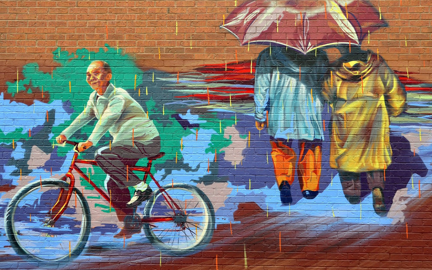 Mural in Chinatown showing a man riding a bicycle