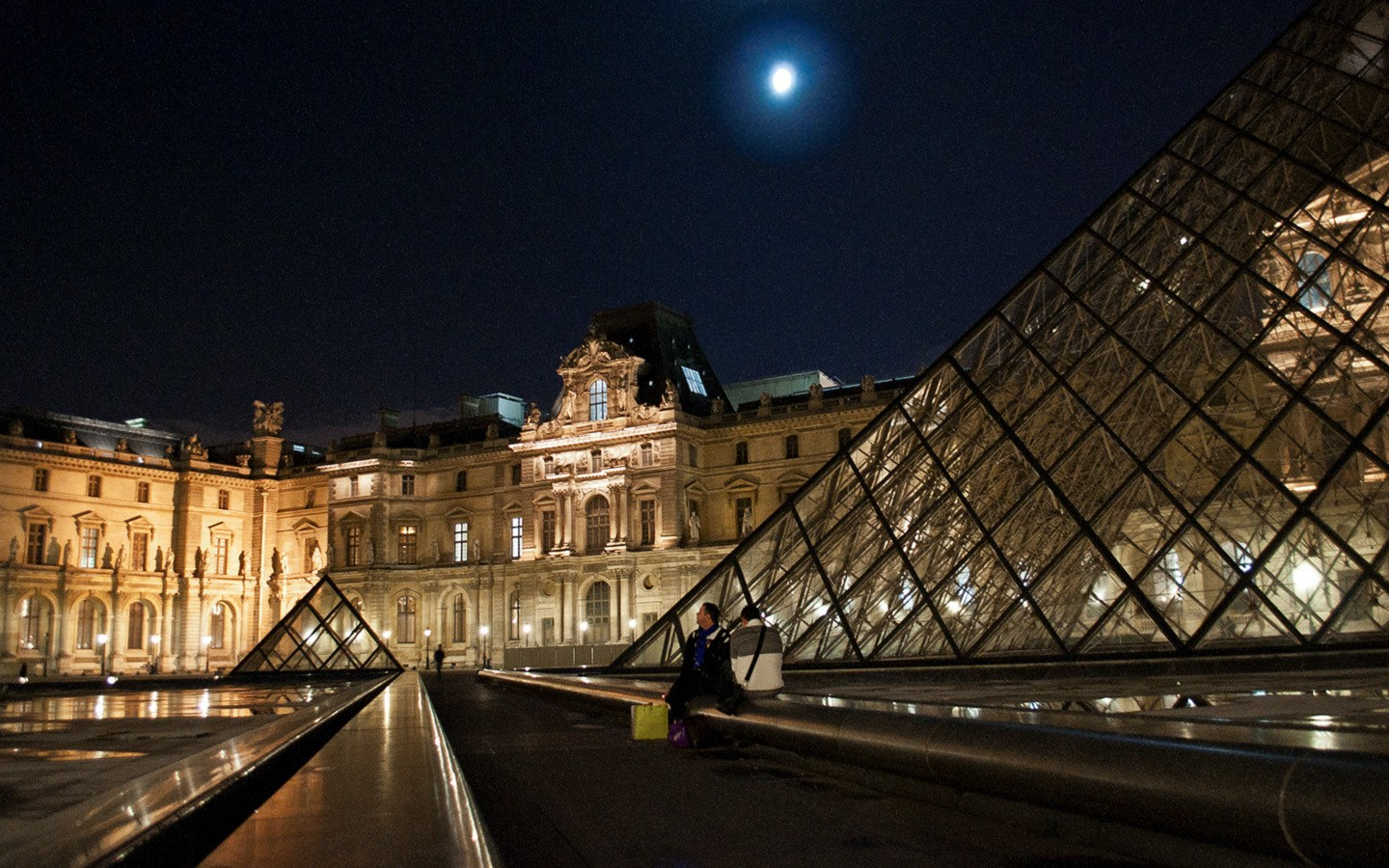 The Louvre museum in Paris at night
