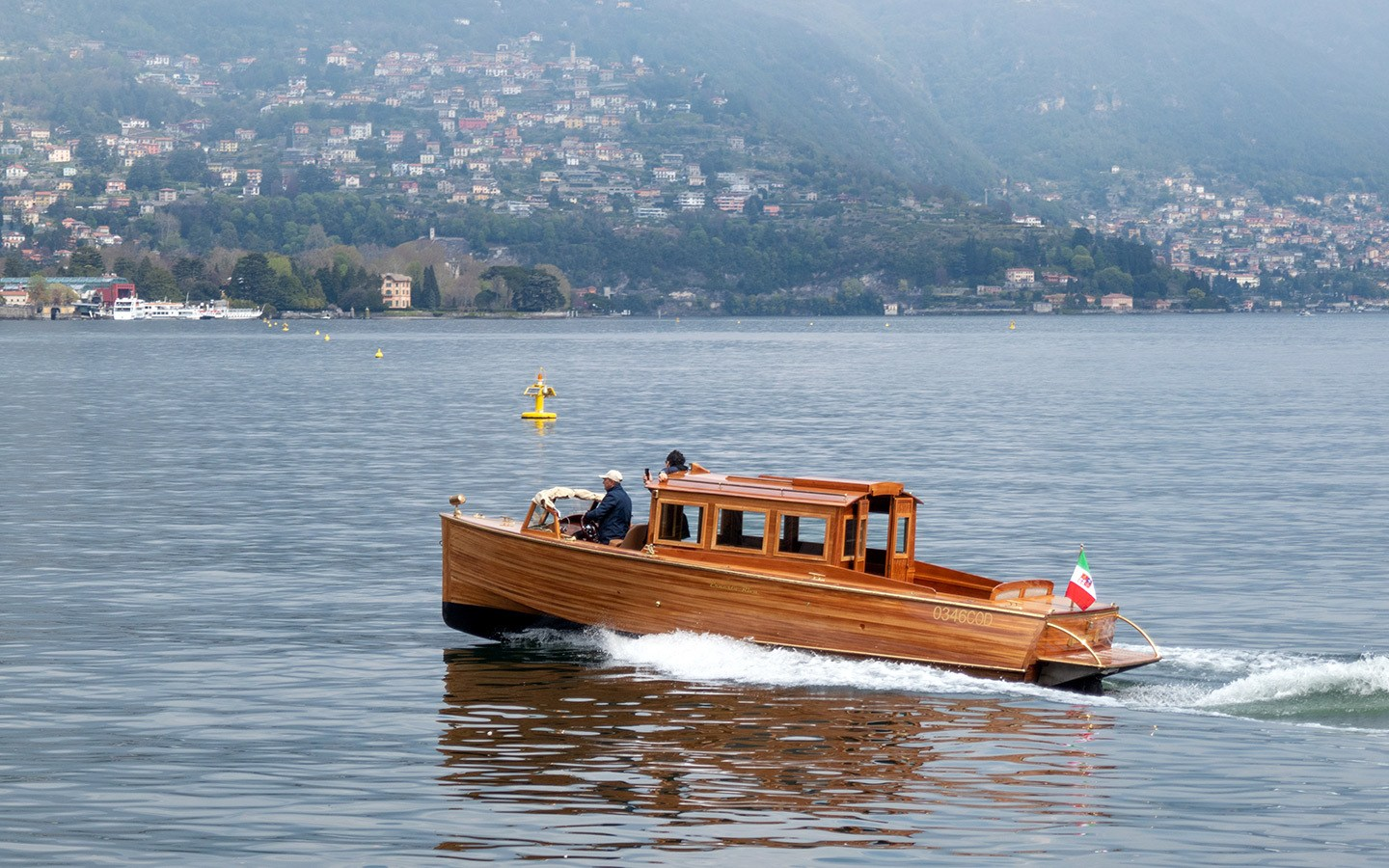 A classic wooden Riva speedboat on Lake Como