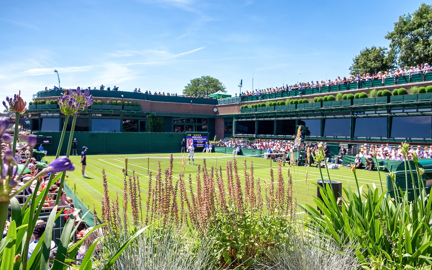 Players on the court at Centre Court at Wimbledon