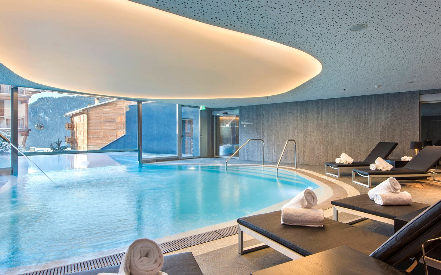 Indoor/outdoor swimming pool and spa at the W Verbier hotel