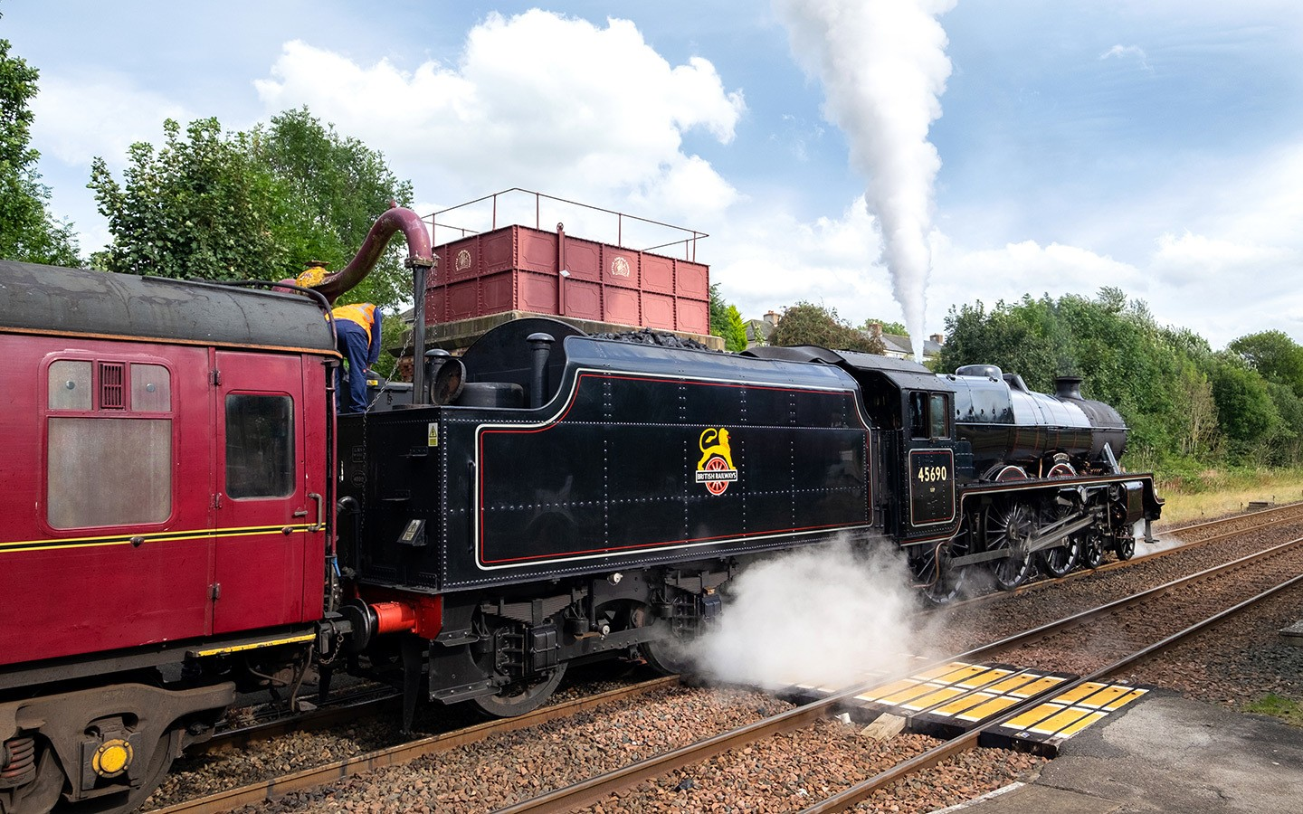 Steam train taking on water at Appleby station on the Settle to Carlisle Railway