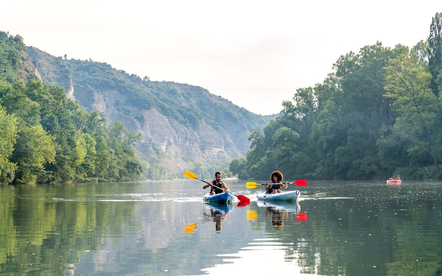 Two kayakers on the river in the Ardèche in France