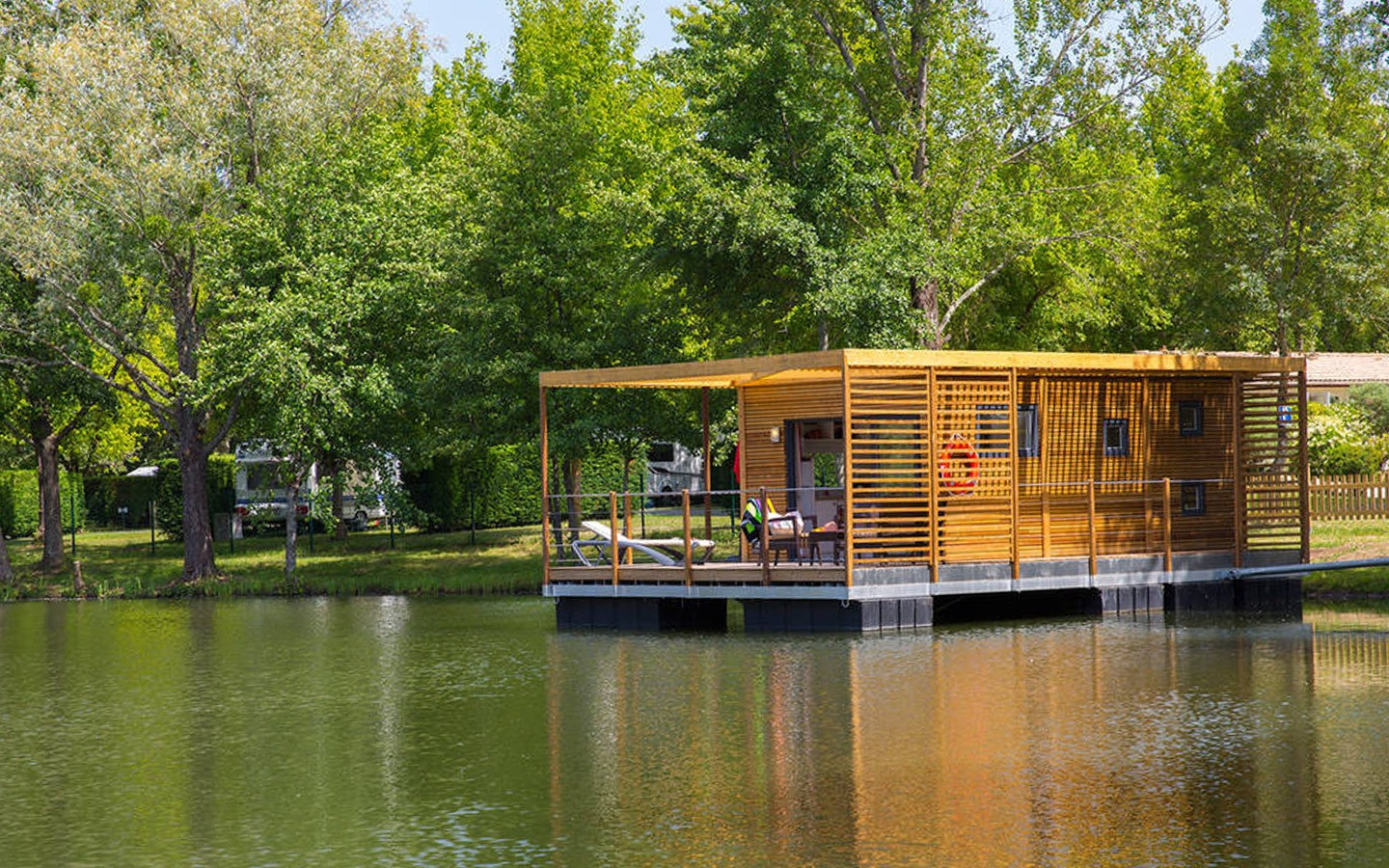 A waterfront cabin glamping site in France