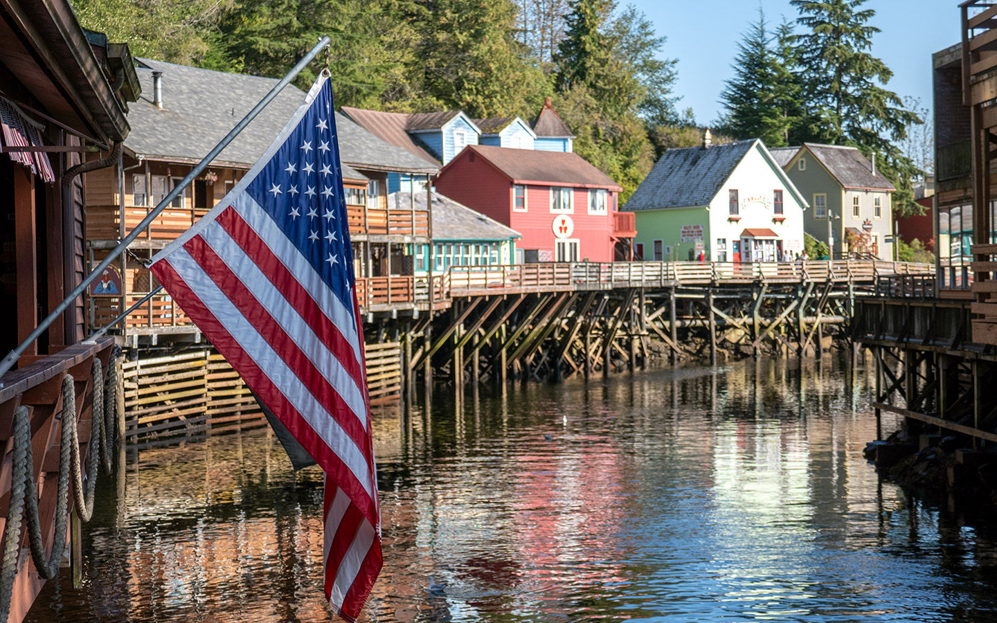 US flag flying along the waterfront in Ketchikan Creek Street