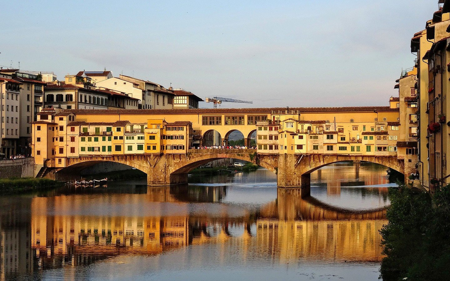 The Ponte Vecchio bridge in Florence at sunset