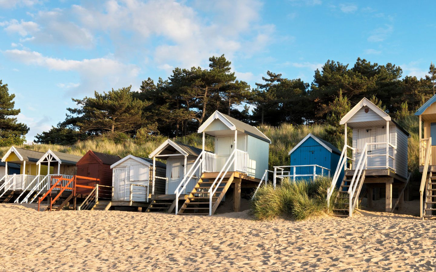 Beach huts at Wells-next-the-Sea in North Norfolk, on a walking holiday in the UK [photo credit Canva]