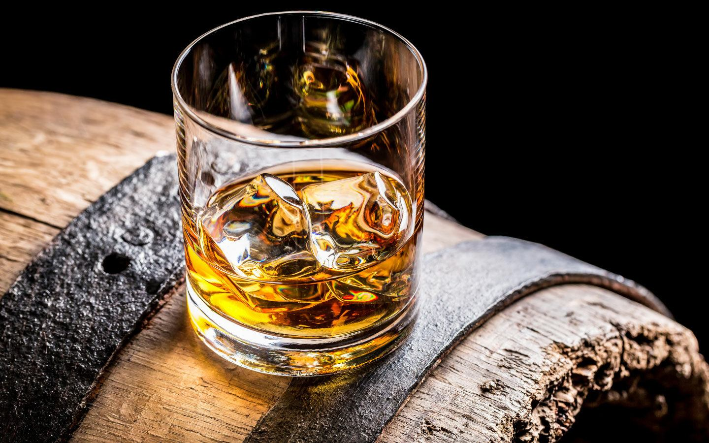 Glass of whisky on a barrel at a whisky tasting in Scotland